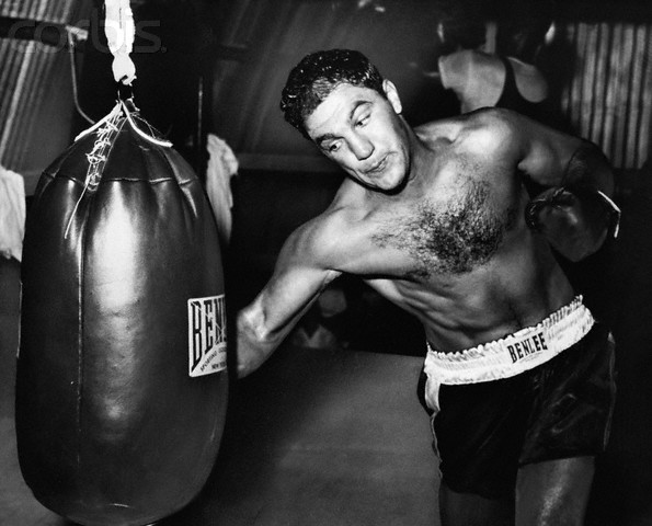 Boxer Rocky Marciano Practices on Punching Bag